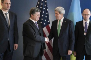 Poroshenko and Kerry shake hands prior to a meeting during the Munich Security Conference